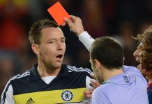 Chelsea's defender John Terry receives a red card from Turkish referee Cuneyt Cakir